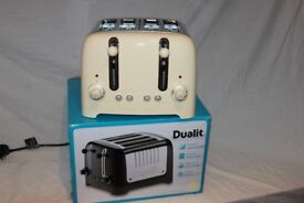 Boxed Dualit Cream Lite 4-slot toaster.