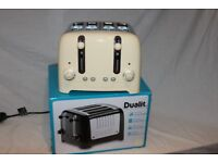 Boxed Dualit Cream Lite 4-slot toaster.