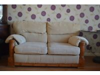 2 Seater sofa with wooden frame for sale Cream color