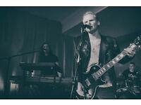 Creative atmospheric guitar player a rock band