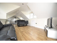 aa stunning two bedroom penthouse on the top floor of a Victorian building with incredible of London