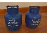 Two 4.5Kg butane gas bottles; one empty, one with 1.6Kg butane remaining