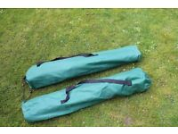 pair of folding green camping/fishing chairs
