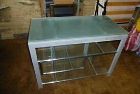 Quality glass and chrome display/tv unit with shelves.