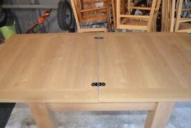 NEXT extending dining room table; light oak effect