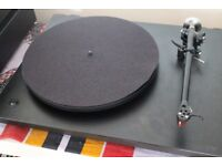 REGA P3-24 turntable with Ortofon Red needle.