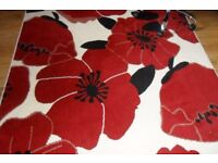 Red and cream flowery design 5 foot by 7 foot rug