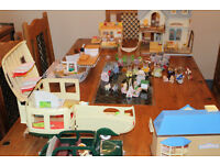 Six Sylvanian families plus restaurant, toy shop, boat, food stall, car and caravan