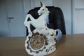 Beautiful white and gold unicorn clock