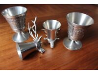 Two pewter goblets and whisky cups.
