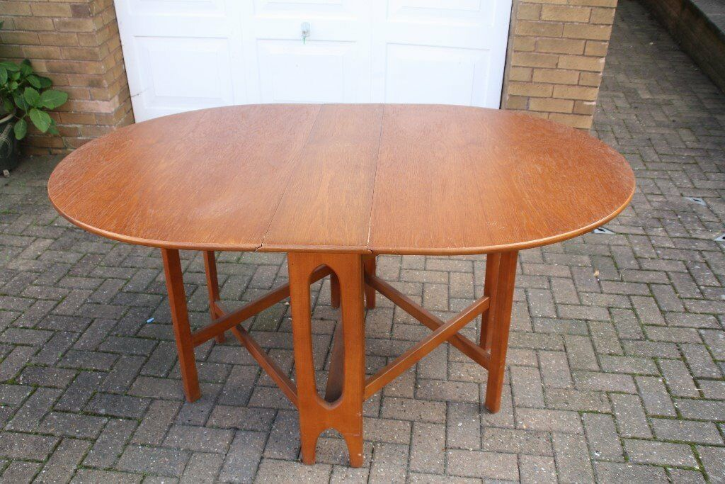 Lovely wooden drop leaf dining table