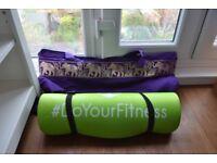 Yoga mat with a carry bag