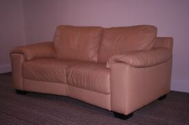 Pair of comfy cream leather sofas.