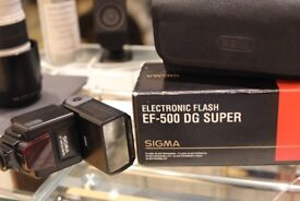 For Sale 2 Sigma Canon fit EF-500 DG Super Electronic Flash Guns.