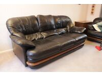 Pair of black leather sofas - two and three seater