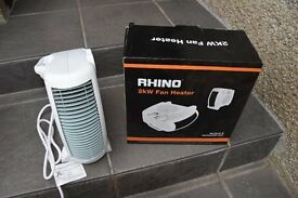 Brand New and in box a Rhino compact and portable fan heater for sale.
