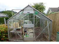 Large 8' by 10' aluminium greenhouse with potting bench