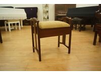 Newly upholstered antique piano stool
