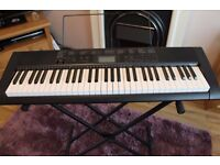 CASIO CTK-1150 Keyboard (full size keys), adjustable stand and a selection of books.