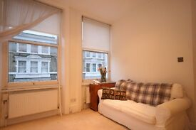 Beautiful Period featured 1 bed property minutes' walk to Barons court station! Great Price £300pw!