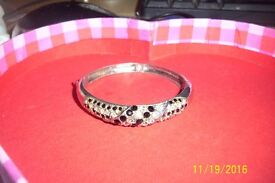 ladies bangles has loads of clear and black gems no stones missing