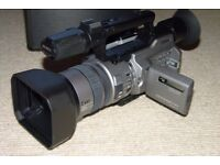 Sony DCR-VX2100E Digital Video Camera with lots of accessories.
