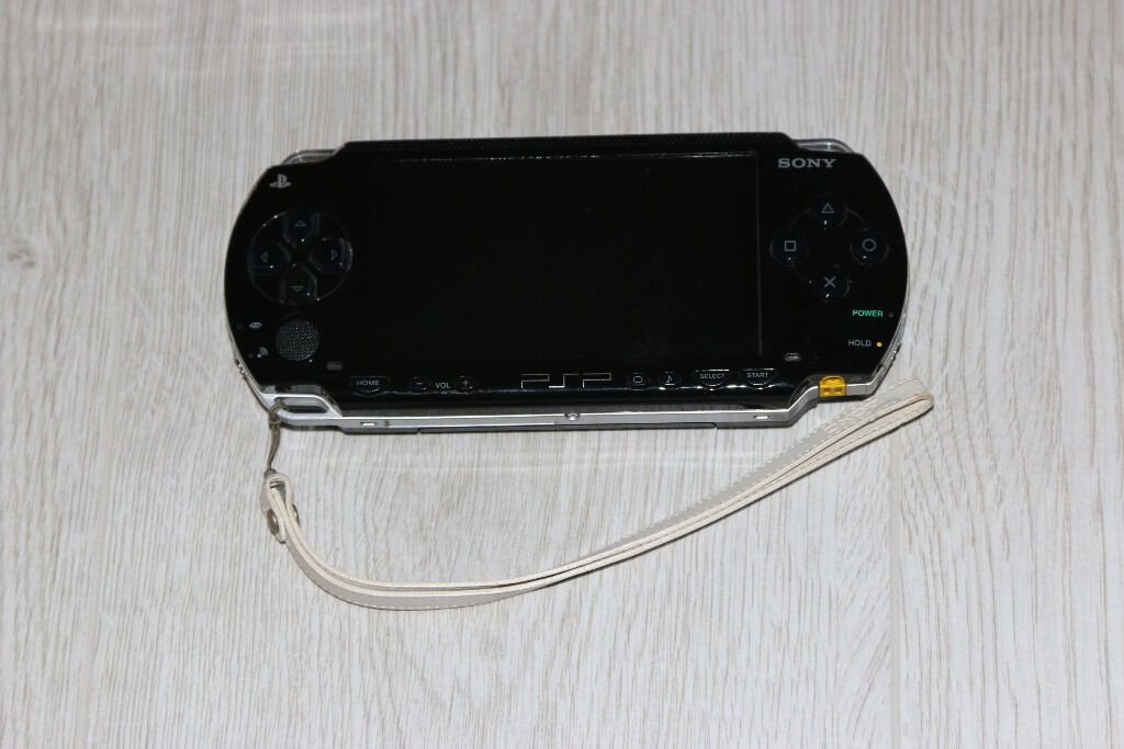 sony psp with 11 games and 7 films