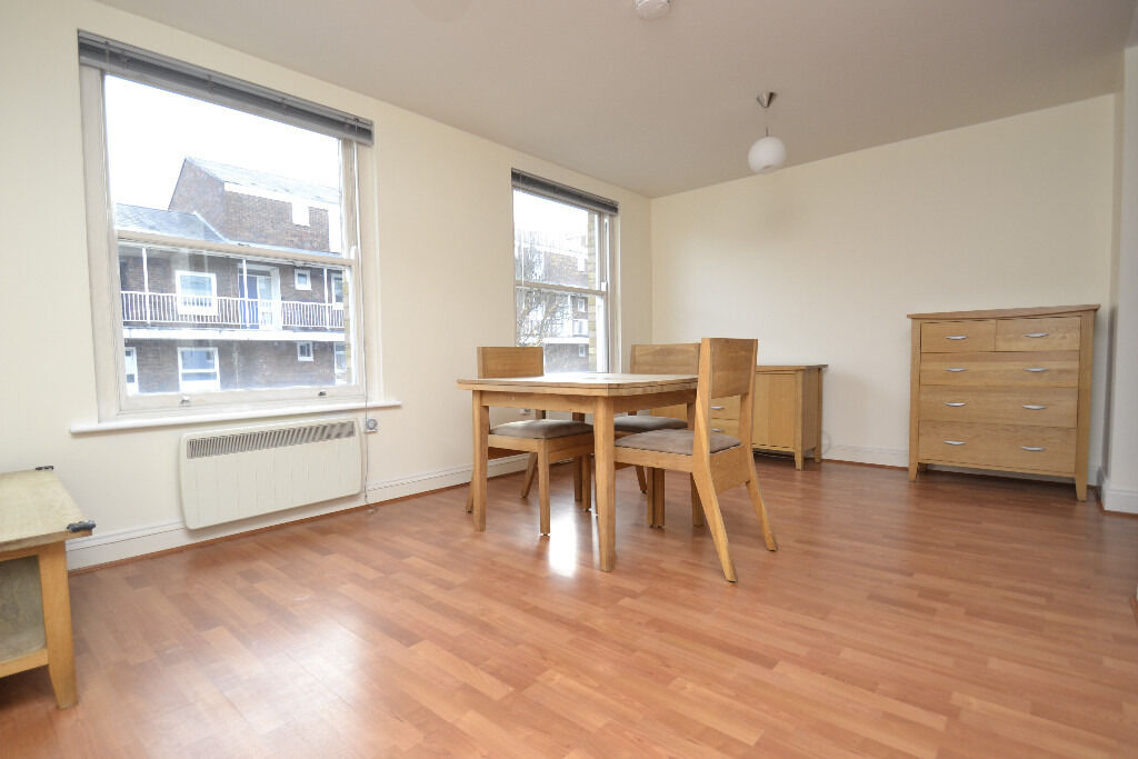 Modern first floor two bedroom flat in a private gate development.