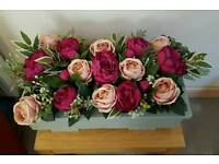 Beautiful artifical flowers in wooden box