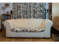 Good quality white sofa bed with two covered cushions. Folds out to make a comfortable double bed.