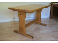 Solid pine dining/kitchen table.