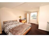 A LARGE DOUBLE LOFT ROOM WITH MODERN EN-SUITE BATHROOM IN FAMILY HOME, UTILITY BILLS INCLUDED