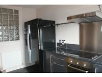 Large modernised 2 bed roomed flat overlooking Stoke Park, Guildford.