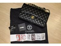 Ladies Chanel classic bag Jumbo size at caviar leather