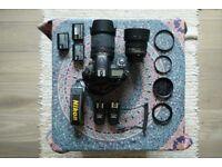 Nikon D7000 DSLR camera + 2 lenses (50mm f/1.8 + 18-105mm f/3.5-5.6) + free extras