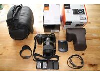 sony a6000 camera + E 18-200mm F3.5-6.3 oss le lens and accessories