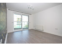 2 bed, 2 bath apartment with internal lake view & private balcony, in the Royal Arsenal development