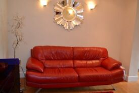 Sofa, red leather, with stainless steel feet. Very good condition