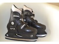 Black SFR ice skates in the box - adjustable size from 3 to 6/35.5 to 39.5
