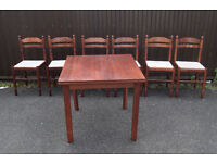 wooden extending dining table and set of 6 matching cushioned chairs CB1 £60