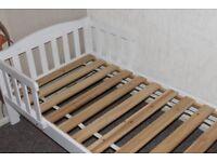 wooden children's bed with mattress