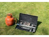 Camping stove, gas cylinder and cooking station