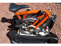 Brompton 3 speed foldable bicycle with additional upgrades and accessories.