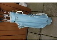 blue golf caddy and clubs