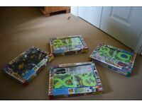 Four Vehicle puzzle play sets including vehicles and accessories
