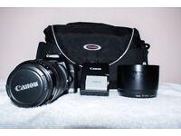camera with lens and shoulder bag +batterys -sd card uv filter.