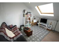 Top floor flat-Spacious living room-Open-plan kitchen-One double bedroom-Close to station-Call now