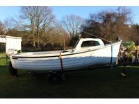 For sale 17 ft open fishing boat with trailer.