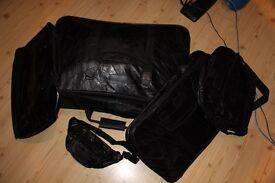 5 piece black leather suitcase set (new)