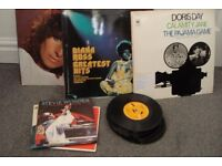 23 l.p. vinyl records assorted music. 28 vinyl singles
